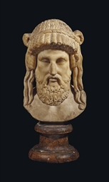 A Roman Marble Head Of Dionysos Circa 2nd Century A D