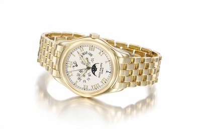 Patek Philippe An 18K gold automatic annual calendar wristwatch with power reserve moon phases