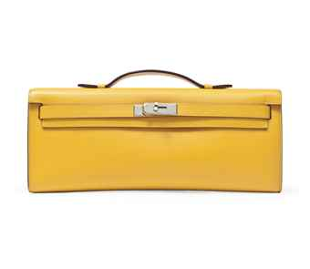 A YELLOW LEATHER KELLY CUT CLUTCH BAG