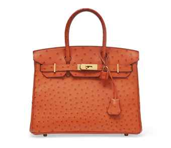 AN ORANGE OSTRICH BIRKIN BAG