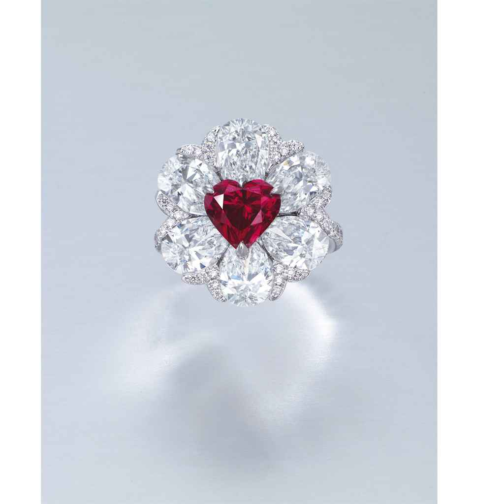 A Stunning Coloured Diamond And Diamond Ring By