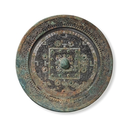 a large bronze 39 tlv 39 circular mirror china western han xin dynasty ist century ad christie 39 s. Black Bedroom Furniture Sets. Home Design Ideas