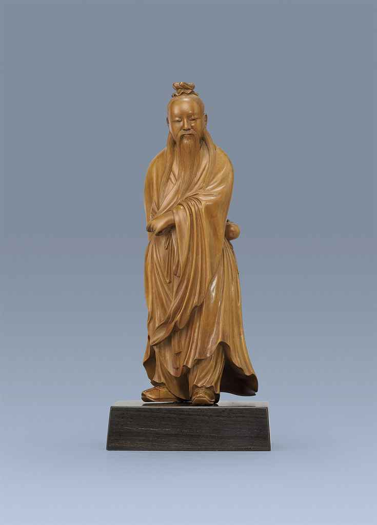 A carved boxwood figure of scholar late qing early
