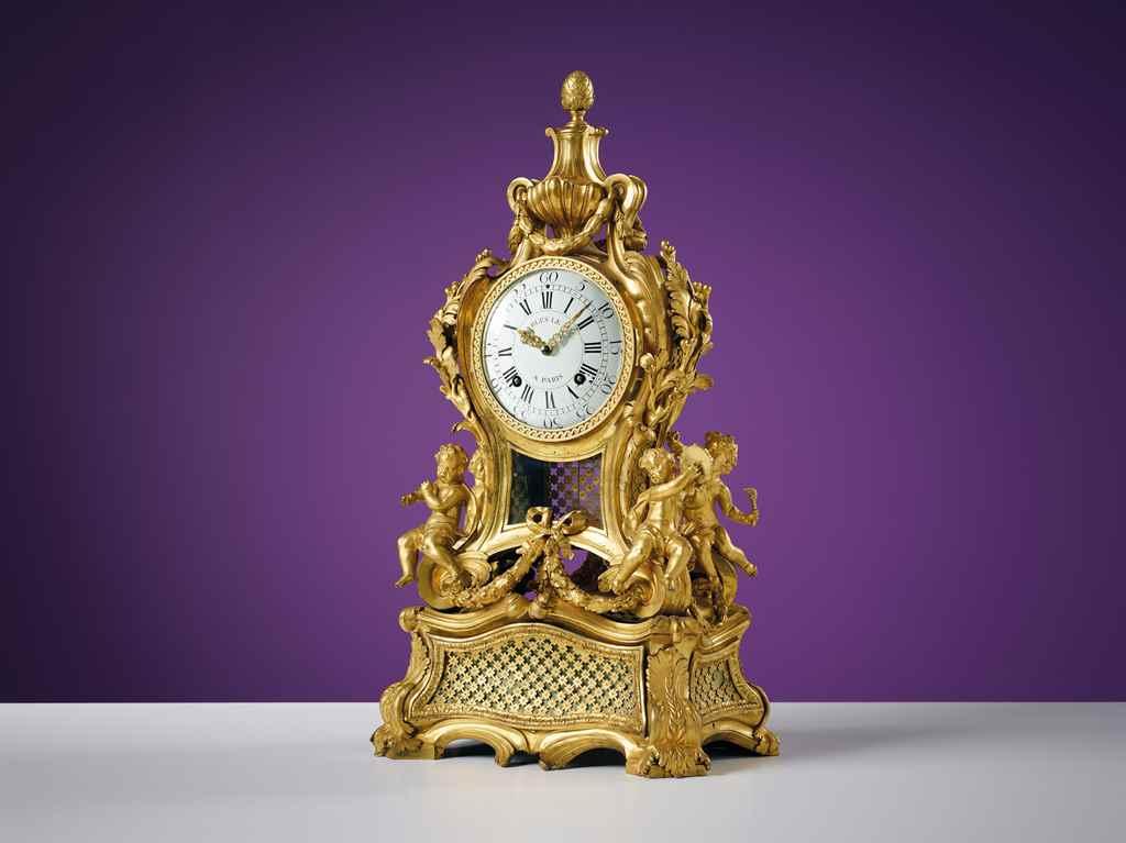 a louis xv ormolu striking musical mantel clock. Black Bedroom Furniture Sets. Home Design Ideas