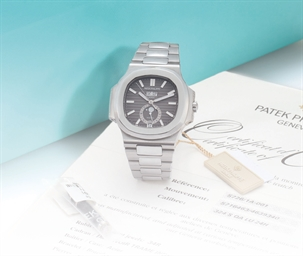 PATEK PHILIPPE A FINE AND RARE STAINLESS STEEL AUTOMATIC ANNUAL CALENDAR WRISTWATCH WITH SWEEP