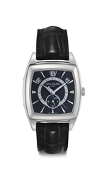 Patek Philippe A Platinum Automatic Tonneau shaped Annual Calendar Wristwatch Moon Phases and