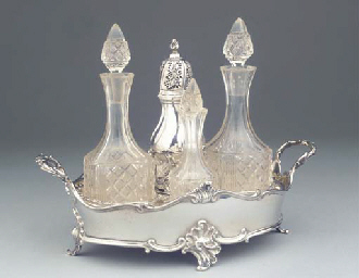 (7) A FINE DUTCH SILVER BREADBASKET WITH CRUET STAND <BR>