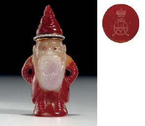 A RARE AND HIGHLY IMPORTANT CARVED CARNELIAN FIGURE OF A GNO