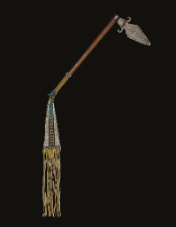 A NORTHERN PLAINS TOMAHAWK WITH BEADED BUFFALO HIDE DROP
