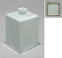 A WHITE PORCELAIN SQUARE BOTTLE