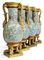 A SET OF FOUR EMPIRE ORMOLU-MOUNTED CHINESE PORCELAIN BALUST