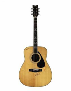 An acoustic Yamaha FG-340 guitar, played by George Harrison