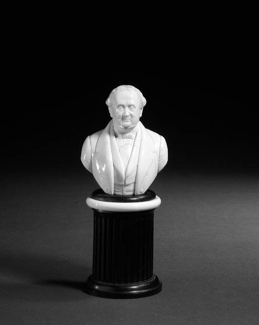 A carved ivory bust of Lord Pa