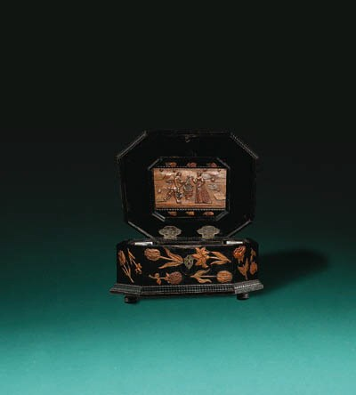 AN EBONISED AND STAINED CARVED