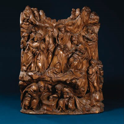A carved wooden relief depicti