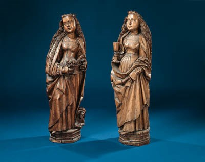 A pair of carved wooden female