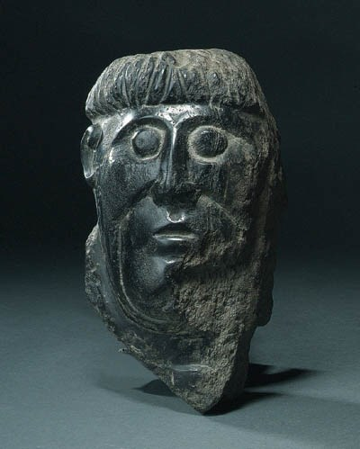 A FRAGMENTARY CARVED STONE HEA
