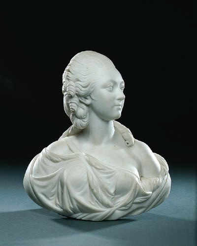 A CARVED MARBLE BUST OF MADAME