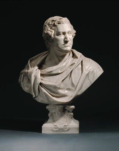 A CARVED MARBLE BUST OF HENRY