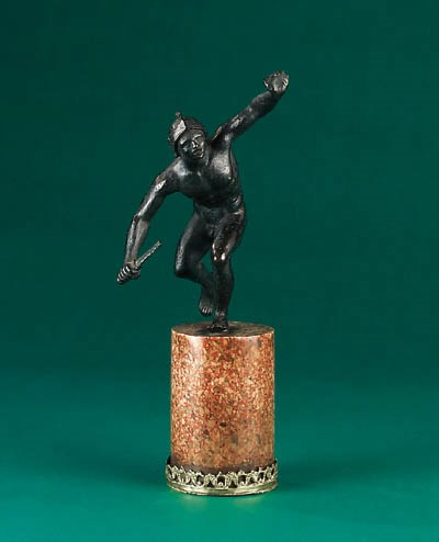 A bronze figure of a crouching