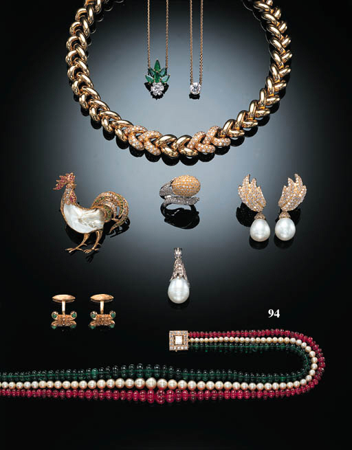 A RUBY, PEARL AND EMERALD THRE