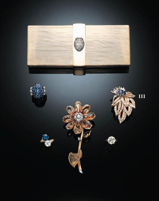 A DIAMOND AND SAPPHIRE BROOCH,