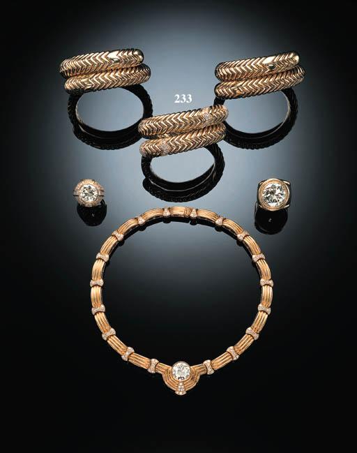 "A DIAMOND AND 18K GOLD ""SPIGA"" BANGLE, BY BULGARI"