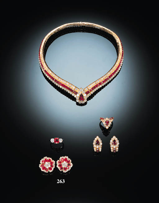 A PAIR OF RUBY AND DIAMOND FLOWERHEAD EARCLIPS