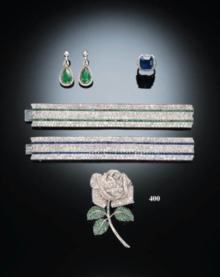 A DIAMOND AND EMERALD FLOWER C
