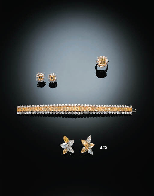 A PAIR OF FINE DIAMOND AND FANCY INTENSE YELLOW DIAMOND EARCLIPS