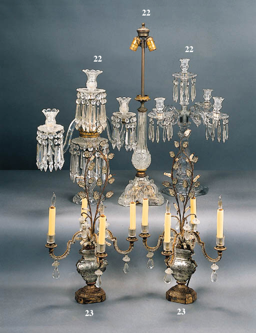 A PAIR OF ITALIAN ROCOCO STYLE COLORLESS GLASS FOUR-LIGHT CANDELABRA