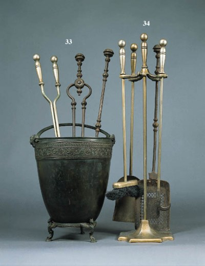 A SET OF WROUGHT-IRON FIRE TOO