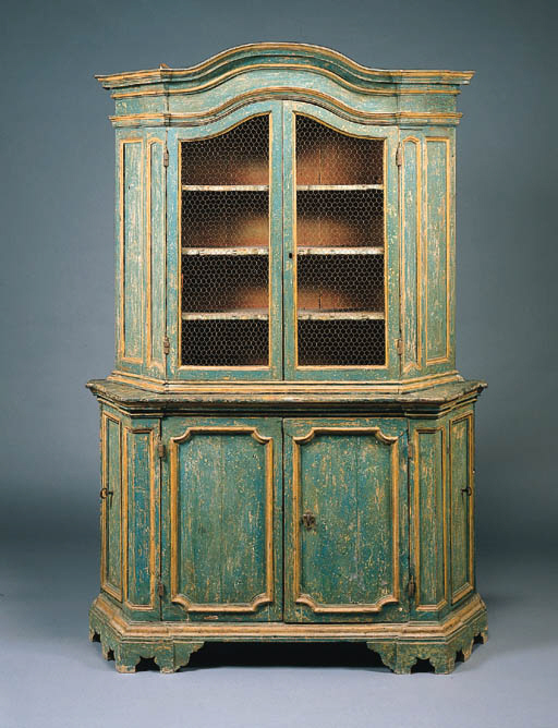 AN ITALIAN BAROQUE GREEN-PAINTED AND PARCEL-GILT VITRINE-CABINET