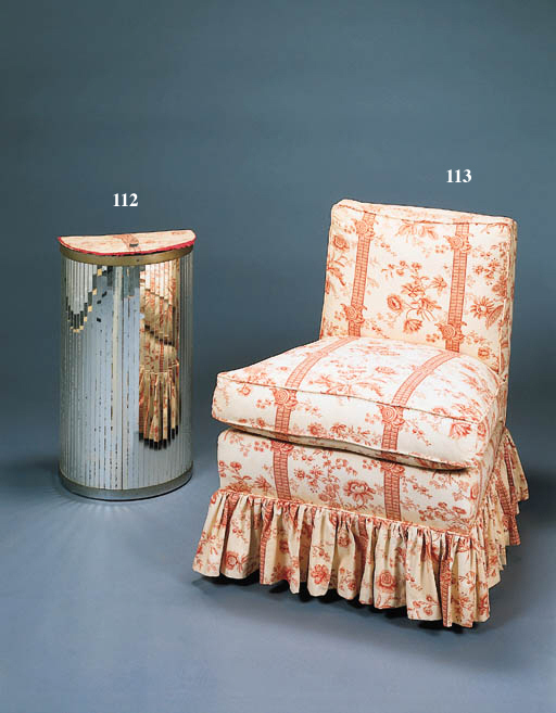A RED-AND-WHITE STRIPED FLORAL UPHOLSTERED DRESSING CHAIR