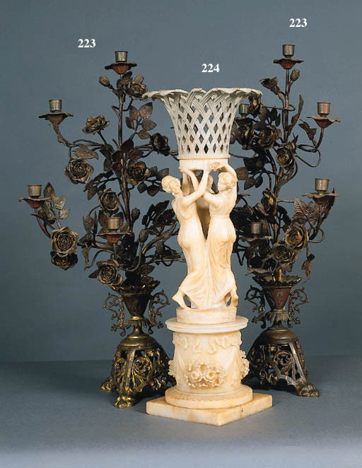 A PAIR OF ITALIAN ROCOCO STYLE GILT AND PATINATED BRONZE SEVEN-LIGHT CANDELABRA