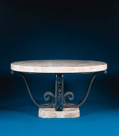 A WROUGHT-IRON CENTER TABLE