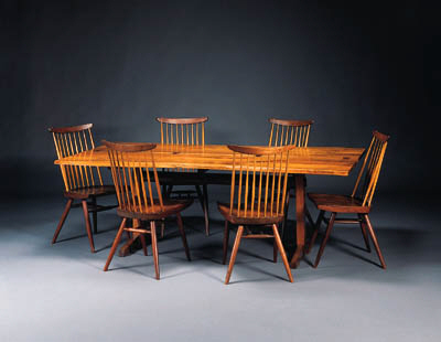 A WALNUT AND ROSEWOOD DINING T