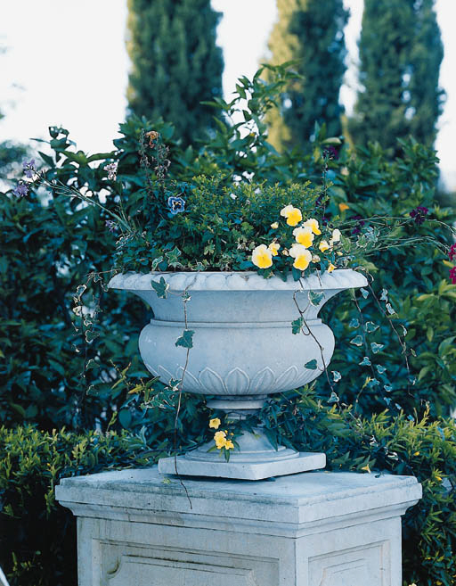A SET OF FOUR WHITE MARBLE URN