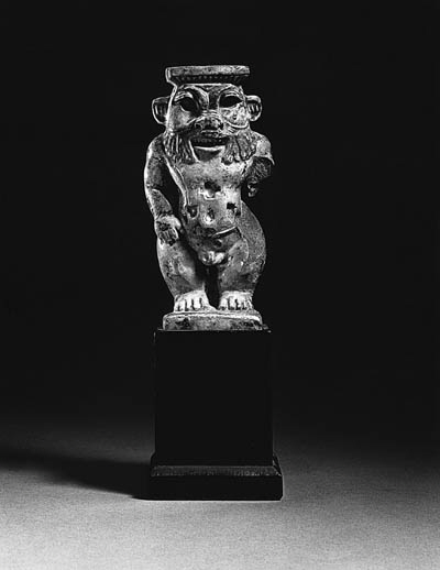 A FAIENCE FIGURE OF BES