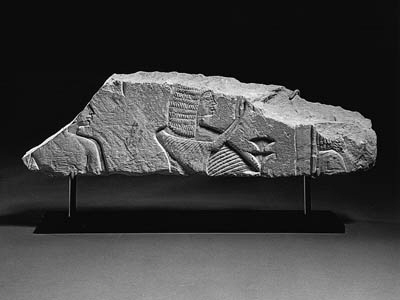 A LIMESTONE RELIEF FRAGMENT