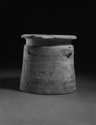 A BABYLONIAN POTTERY JAR