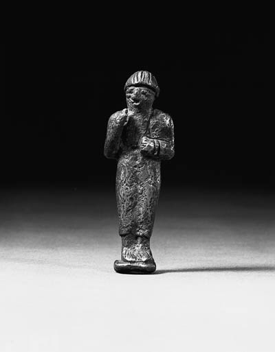 AN ELAMITE SILVER FIGURE OF A