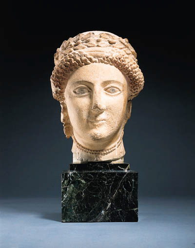 A CYPRIOT LIMESTONE HEAD OF A