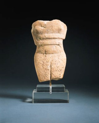 A CYCLADIC MARBLE FEMALE TORSO