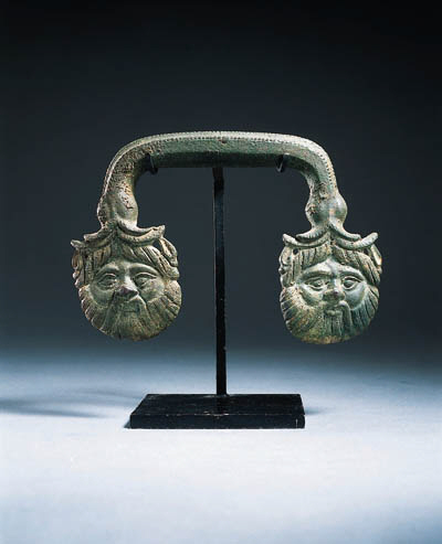 AN ETRUSCAN BRONZE HANDLE