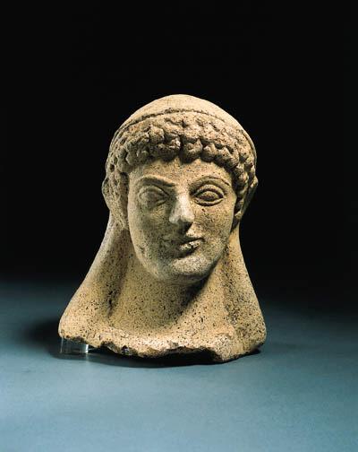 A GREEK TERRACOTTA HEAD OF A K