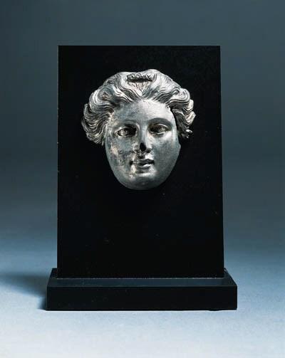 A GREEK SILVER HEAD OF A WOMAN