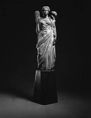 A ROMAN MARBLE FIGURE OF APHRO