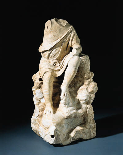 A ROMAN MARBLE FIGURE OF A FISHERMAN