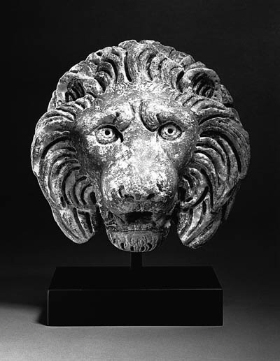 A ROMAN MARBLE HEAD OF A LION